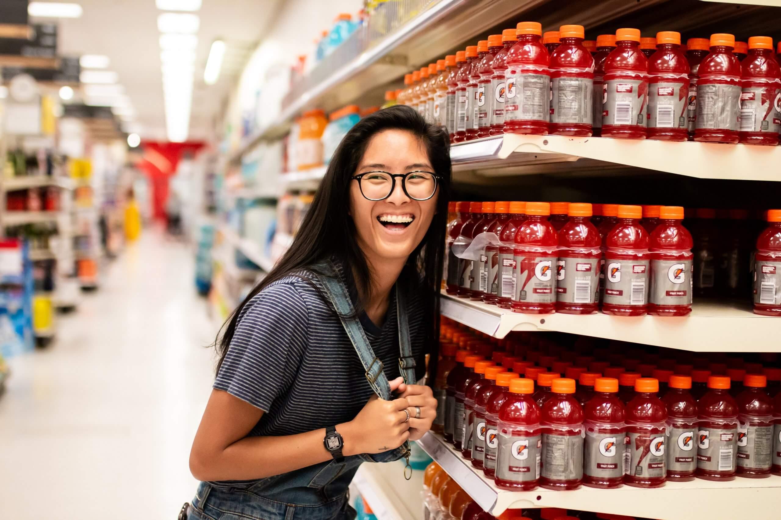 Women Smiling Next to Gatorade Bottles
